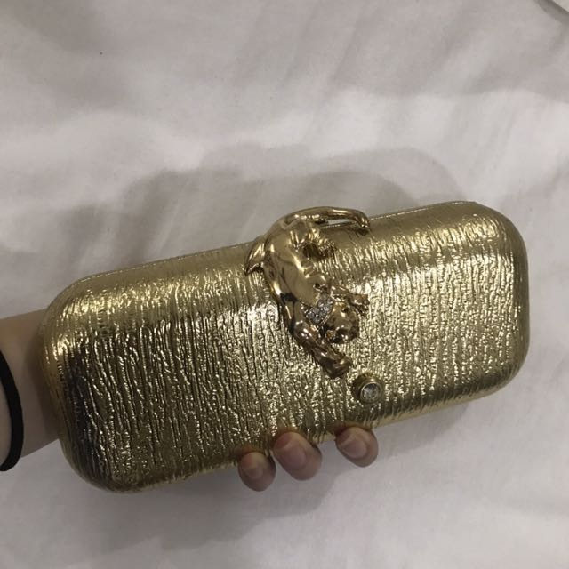 Gold party clutch bag