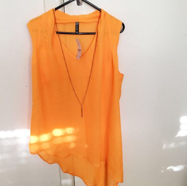 ORANGE TOP NEW WITH TAG