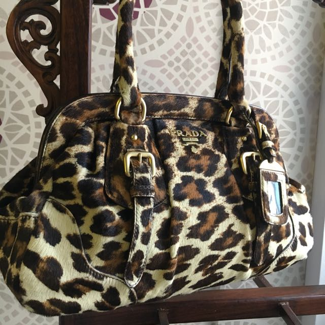 7601fb35fbdf Prada leopard print handbag, Luxury, Bags & Wallets on Carousell