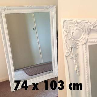Large mirror with detailed frame
