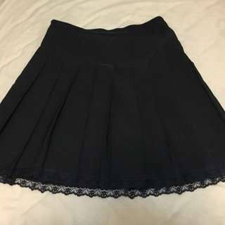 Black pleated skirt with lace detail