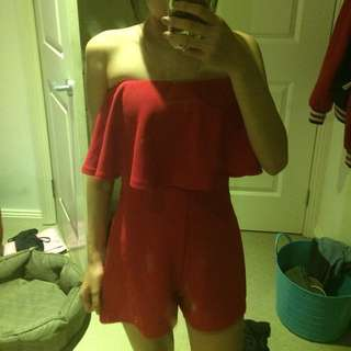 Red strapless playsuit