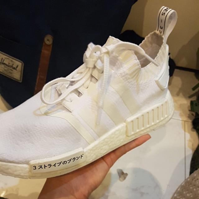 Adidas nmd r1 pk triplo bianco in giappone, sulla moda maschile, calzature