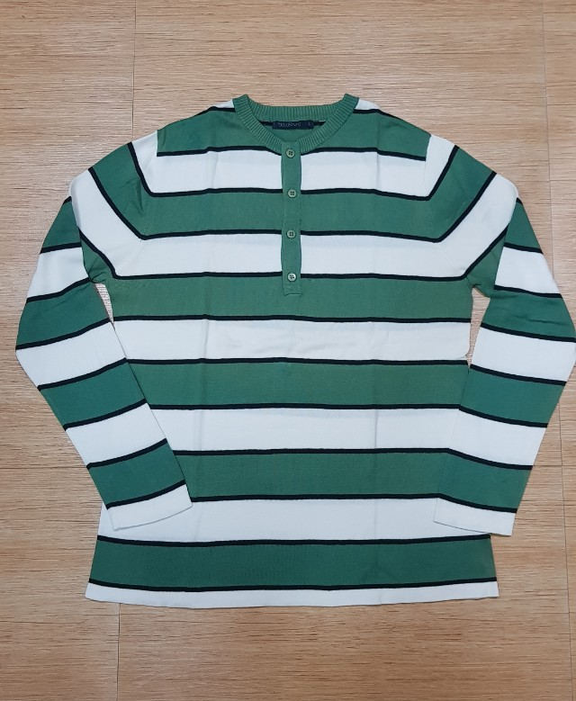 Folded and hung green stripes longlseeve mens