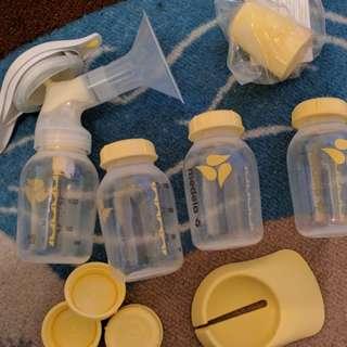 Medela manual pump and bottles