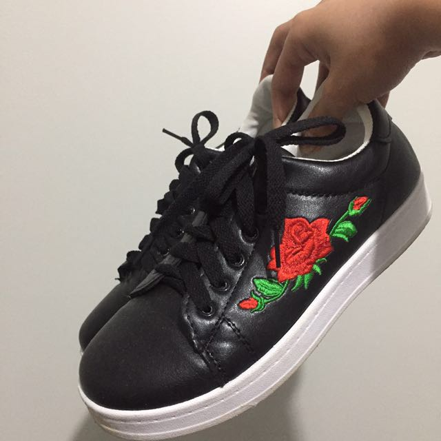 Black sneakers with floral stitching