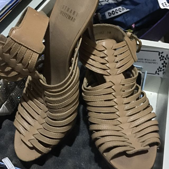 strapy nude heels by stuart weirtzman