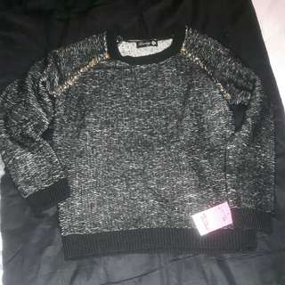 Knit sweater with beaded detail