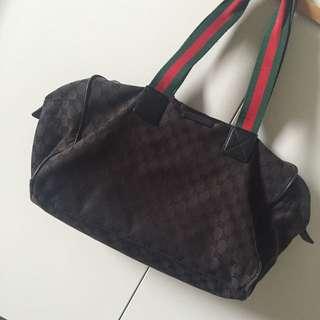 Classic Gucci monogram duffle bag