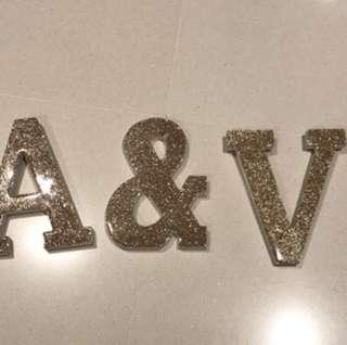 """""""A&V"""" typo shimmering gold wooden letter"""