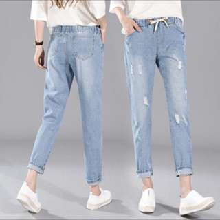 elastic denim ripped jeans