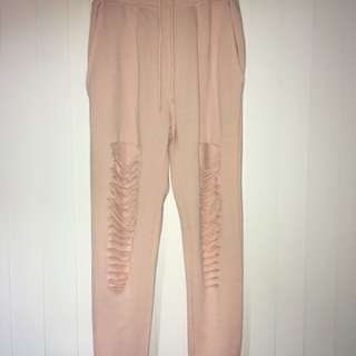 Pink ripped knee sweatpants