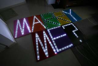 Marry me boards with fairy lights