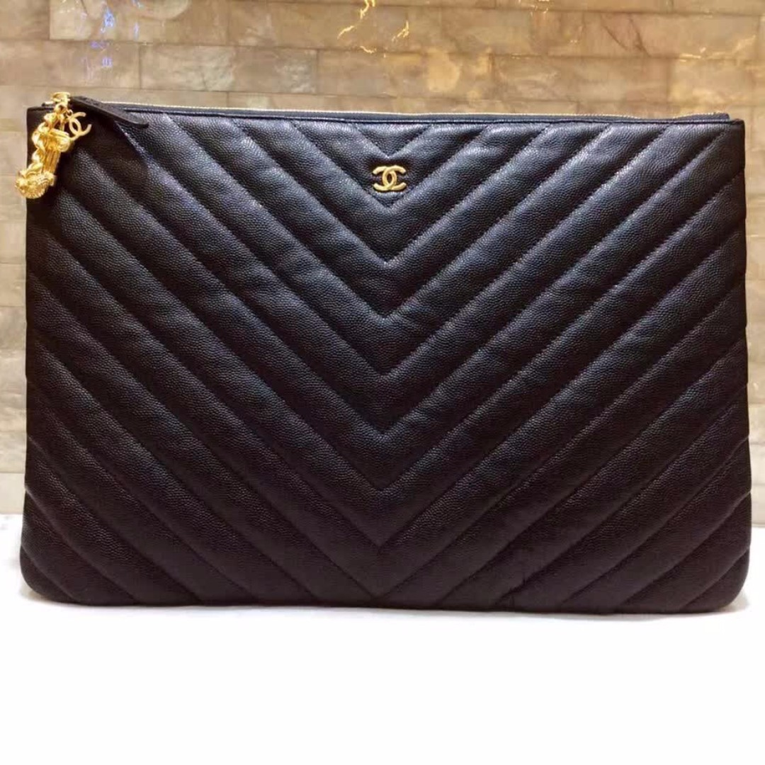 650c74f91a8742 Chanel Chevron O Case with Ancient Greek Charm, Luxury, Bags & Wallets on  Carousell