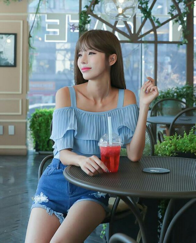 Cold-shoulder pleated blouse