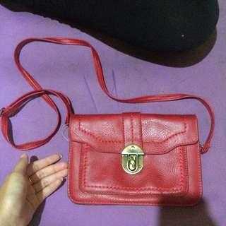 mini red sling bag (naughty)