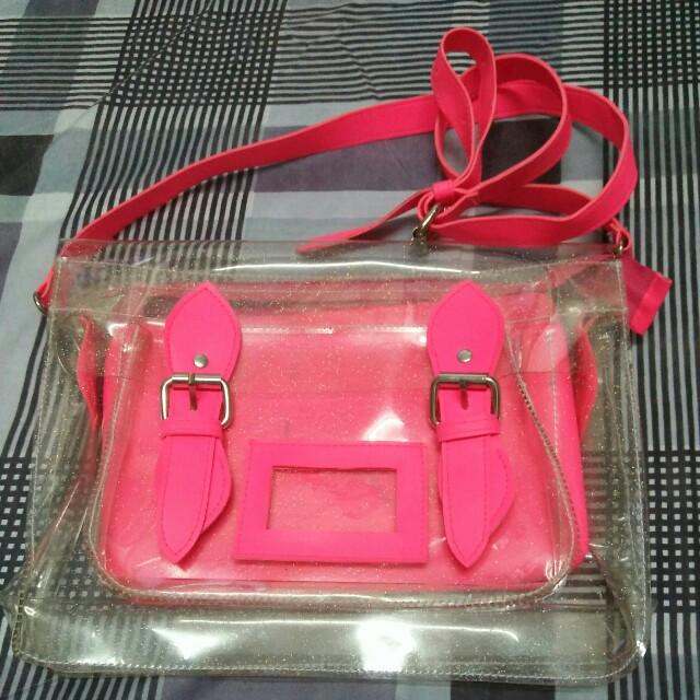 Transparent pink sling bag