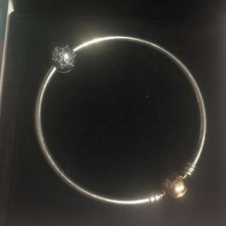 Pandora rose bangle with charm