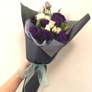 Mix bouquet of purple Eustoma and white roses spray.