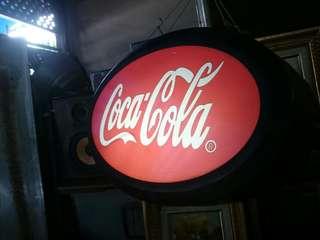 Coca cola signboard lampu