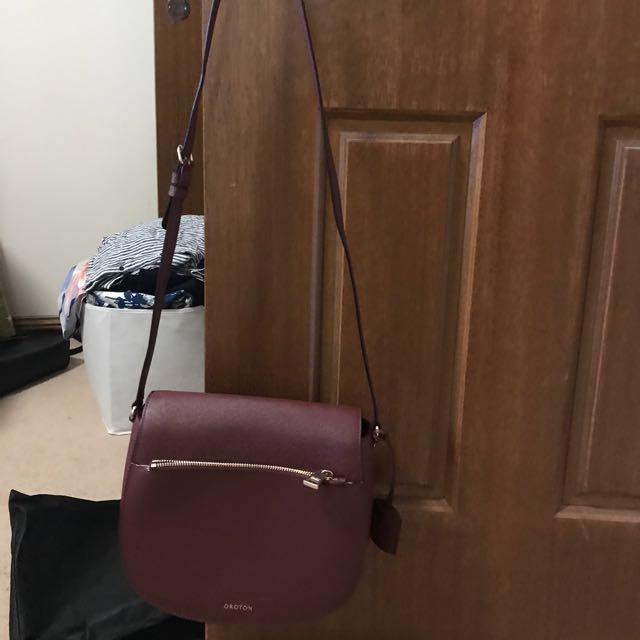 Burgundy oroton cross body bag