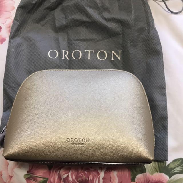 Oroton gold makeup bag