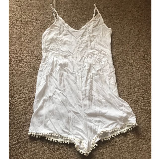 White playsuit with pom poms
