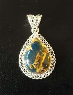 Natural Blue Amber pendant in pure Silver. Origin Dominica.