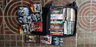 (Negotiable) 60 Original DVD Copies with Original Used Delsey Trolley