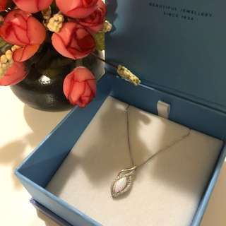 Silver necklace with white opal stone