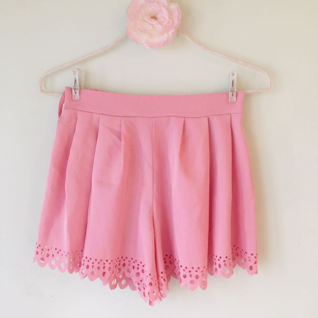 Pleated shorts with laser cut design