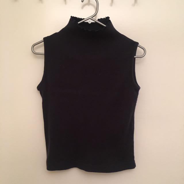 Turtleneck sleeveless top