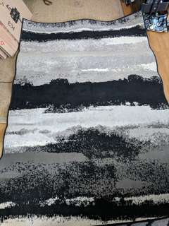 Low-pile Canyon rug in black, white, and grey