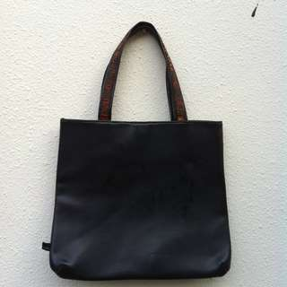 Play black leather bag. In good condition.