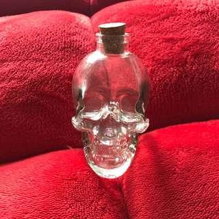 Glass skeleton head bottle