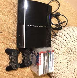 Playstation 3 with 8 games and 2 remotes