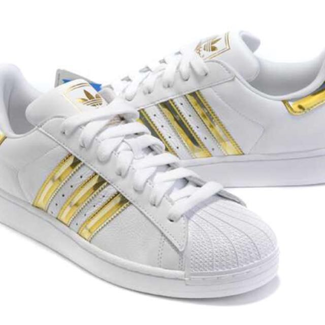 adidas superstars gold stripes