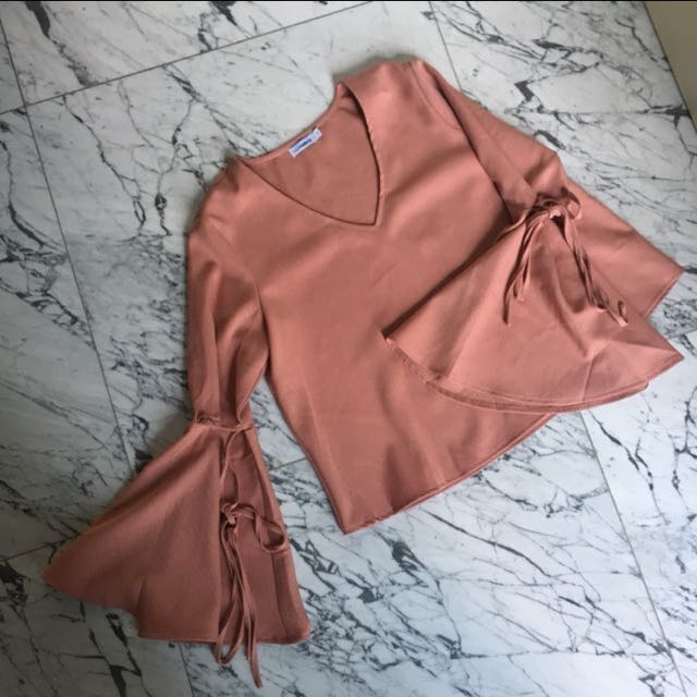 bell sleeved pink top