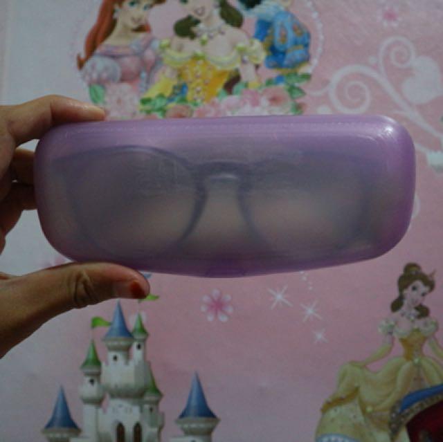 Kacamata bening tosca