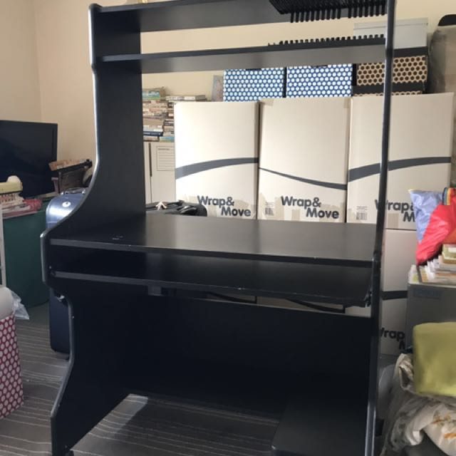 Moving house clearance: black computer desk