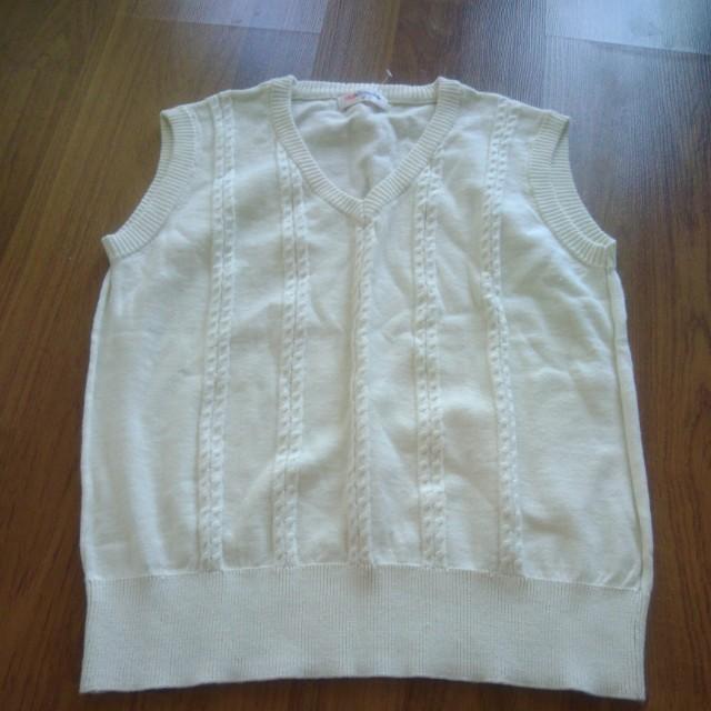 Off white sleeveless sweater
