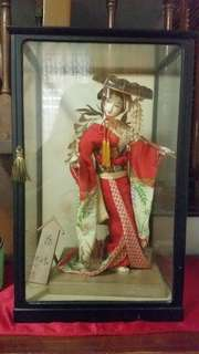 Japanese doll in a glass closet