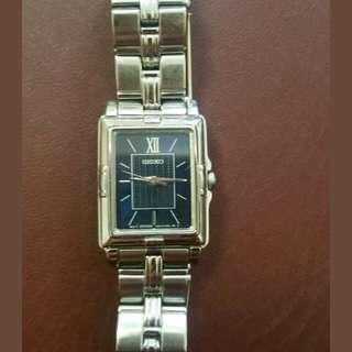 Authentic Seiko ladies watch with rectangular navy face