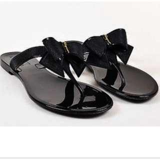 Ferragamo black jelly ribbon slipper