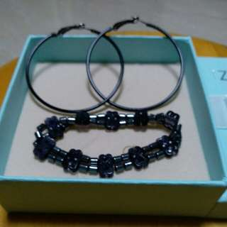 A Pair of earrings  and one matched bracelet