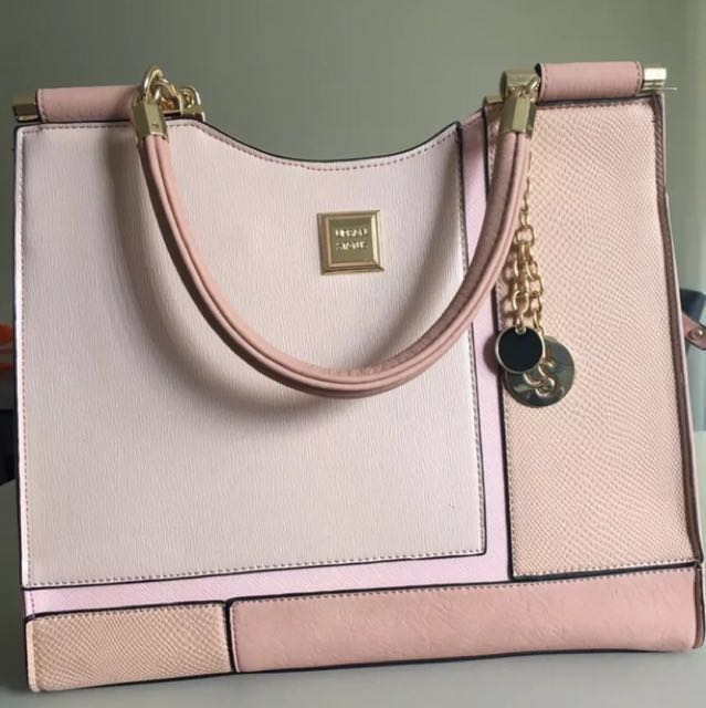 Urban Status Dusty Pink Tote Handbag with longer strap attachment.