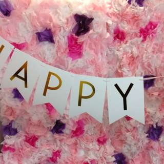 Tissue paper flower wall and bunting banner
