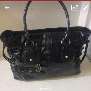 Tods patent shoulder bag