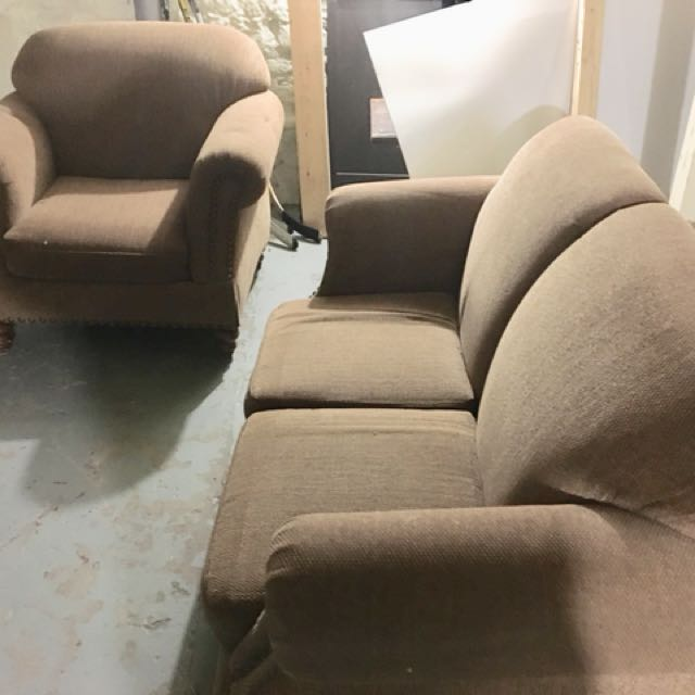 Comfortable and cozy couch and arm chair set.