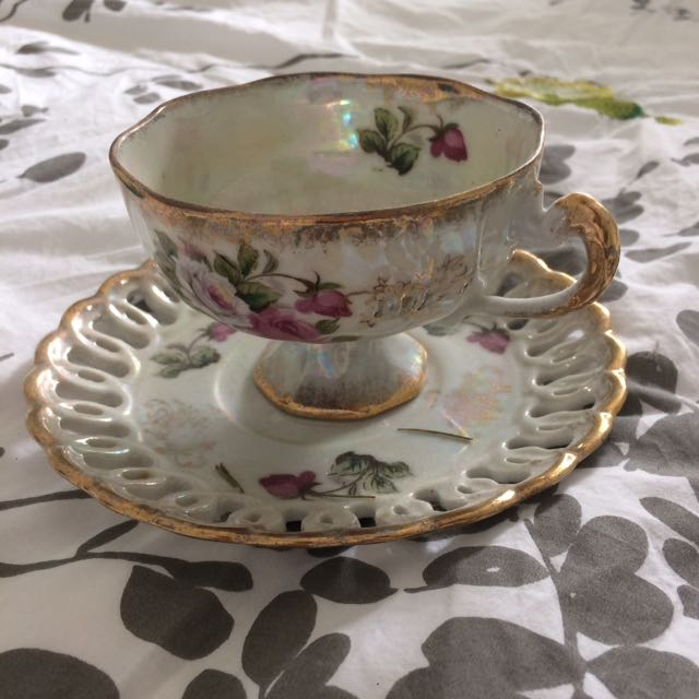 Floral pink and gold vintage tea cup and saucer